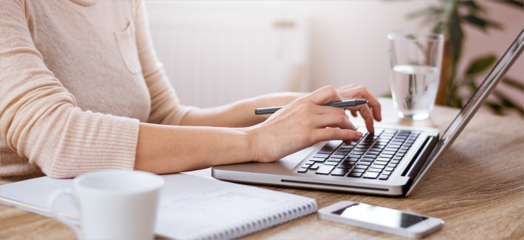 Think like a marketer, woman typing on a laptop